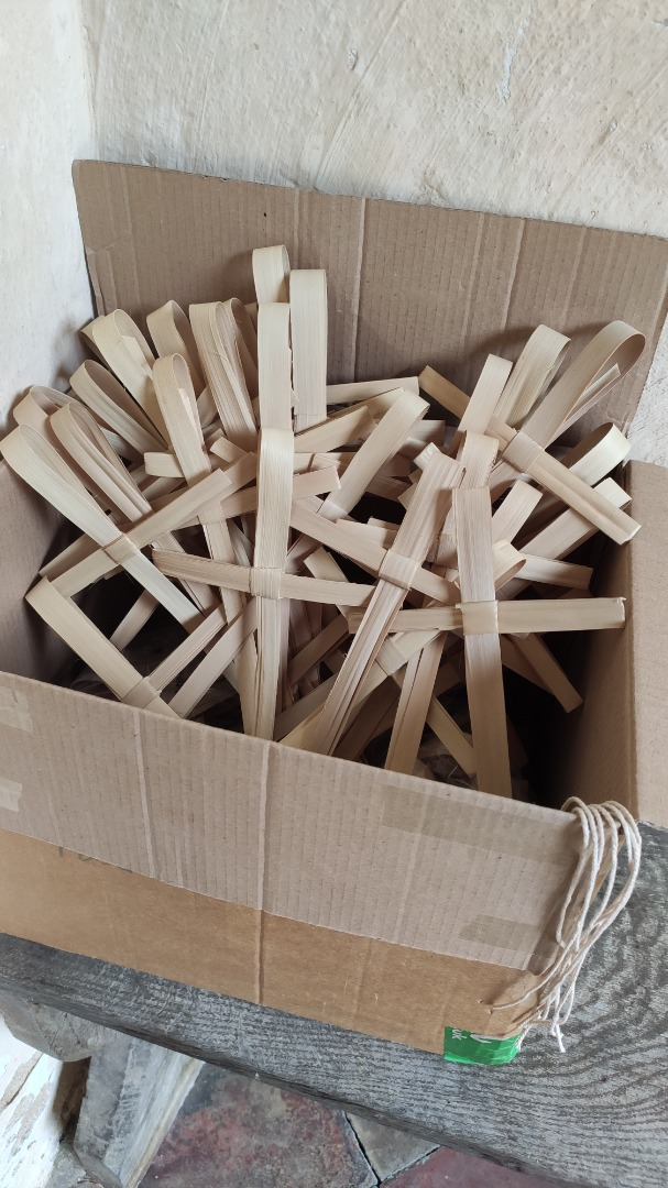 Palm crosses available to hang in memory